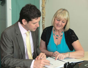 Crunching numbers! Financial director Tricia Jones with Managing Director David